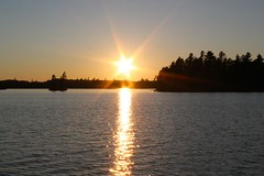 starry sunset (ailie*) Tags: blue trees light sunset summer sky orange sun sunlight lake reflection water star islands golden waves shine bright silhouettes peaceful calm sparkle clear flare rays ailie starburst temagami