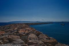 Rock Wall (Keith Cullis Photography) Tags: blue sea sky seascape wall clouds boats spain rocks stones seawall lanscape lestartit