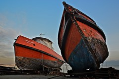 Orange Boats 1 (Paulo N. Silva) Tags: blue sea orange abandoned river wooden setubal shipyard oldboats wodenboats