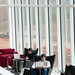 Students study by the large windows inside the Hunt Library.
