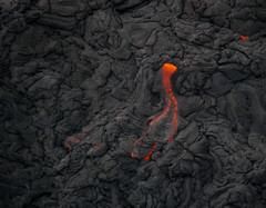 Flowing Lava (Tim Conway) Tags: above trip travel winter red vacation orange usa hot tourism rock america crust flow island fire vent photography kalapana volcano hawaii lava islands big scenery december glow pacific united aerial helicopter waterfalls hawaiian hi states bigisland volcanoes geology helicopters volcanic fromtheair kilauea magma basalt active bluehawaiian lavafield igneous lavaflow lavaplain 2013 puʻu puʻuʻōʻō ʻōʻō