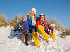 Mother and small children sitting on sledge (dave hanlon) Tags: family winter boy portrait holiday snow playing cold girl kids children fun outside outdoors happy vakantie lol dunes dune sneeuw hill familie kinderen mother kind mum recreation mummy lachen portret moeder duinen pleasure awd lach active sneeuwpret sledge sledging slee muts kou pret koud gezin spelen samen plezier relaxen uitrusten vakantiegevoel familieportret gelukkig laarzen geluk youngfamily vreugde duingebied ontspanning recreatie amsterdamsewaterleidingduinen dezilk ontspannen sleeen sleetje blijheid samenspelen samenzijn jongegezin