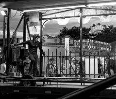 Carnival Operator (HJharland5) Tags: blackandwhite monochrome carnival fair lakecounty ohio amusementpark county rides evening operator summer