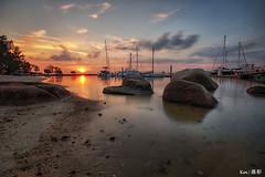 Nongsa Resort beach  sunset (Ken Goh thanks for 2 Million views) Tags: nongsa resort beach boats sunset golden sun blue sky reflection water moving clouds smooth silhouette pentax k1 sigma 1020