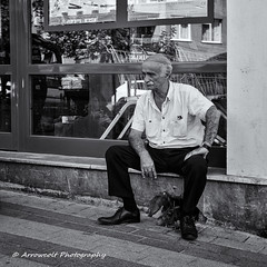 Street 181 (`ARroWCoLT) Tags: streetart oldman sitting doorfront istanbul trkiye trkei turkey street sokak people summer samsung nx mini nxm photography outdoor siyahbeyaz art bw blackwhite monochrome black white blackandwhite arrowcolt nxmini reflection glass shop vitrin showcase 17mm f18 skdar thoughtful