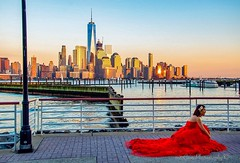Lady in Red and sunset (mitzgami) Tags: inexplore city wedding nikonphotography nikon landscape sunset manhattan red newjersey jerseycity newportwaterfront hudsonriver flickr newyorkcity onewtc