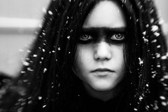 (Kilkennycat) Tags: portrait blackandwhite bw snow bird girl lensbaby canon children wings child serious feathers muse snowing crow 500d kilkennycat t1i ryanconners