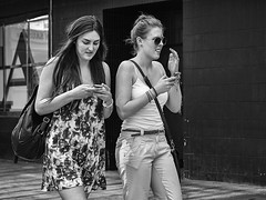 Syncro-Text (Explore - 30 Dec 2012 - #440) (Peter.Bartlett) Tags: street city girls people urban blackandwhite monochrome mobile female pen walking mono blackwhite women unitedkingdom candid yorkshire text leeds streetphotography cellphone olympus mobilephone nik olympuspen westyorkshire blackdiamond browsing texting ep3 explored blackwhitephotos streetphotographyurban niksilverefex microfourthirds