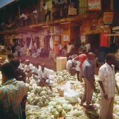 Cabbage seller (sonofwalrus) Tags: africa street people film vegetables holga lomo lomography market scan uganda kampala seller cabbages hpc5380 owinomarkets