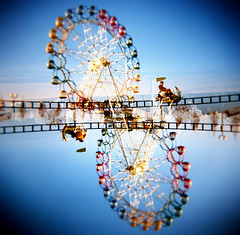funfair in the air (hodachrome) Tags: park winter holga lomography doubleexposure railway double multipleexposure ferriswheel amusementpark rollercoaster doubles
