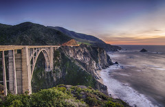 The world is full of magic things, patiently waiting for our senses to grow sharper... (FerPecT_sHotz) Tags: bridge sunset sky concrete pacific bigsur boulders bixbybridge pacificcoasthighway caroute1