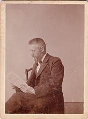 portrait man reading glasses photograph spectacles
