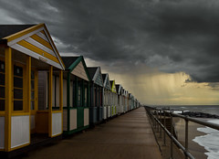 Summer Rain [Explored] (jellyfire) Tags: sky rain weather point golden vanishingpoint suffolk seaside day power cloudy menacing showers drama vanishing southwold beachhuts eastanglia