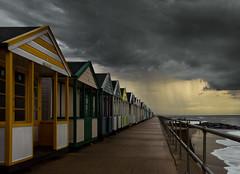 Summer Rain [Explored] (jellyfire) Tags: sky rain weather point golden vanishingpoint suffolk seaside day power cloudy menacing showers drama vanishing southwold beachhuts eastanglia
