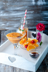 Orange cocktail with ice in a glass (lyule4ik) Tags: cocktail nobody bar beverage drink orange alcohol ice refreshment liquor juice background fresh closeup wet cold table slice natural tropical liquid sweet yellow summer straw refreshing citrus tasty healthy drop garnish cool vitamin selective rum fruity wooden fruit water party nutrition health exotic alcoholic food juicy rustic mixed glass freshness
