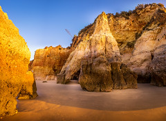 Sunrise on the Rocks (D.ROS) Tags: 2016 beach blue cliff landscape light magenta nature orange plants portimao portugal praiadovau rocks sand seayellow sun sunrise sunset water white supershot