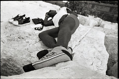 (The Promised Land?) (Robbie McIntosh) Tags: leicamp leica mp rangefinder streetphotography 35mm film pellicola analog analogue negative leicam analogico blackandwhite bw biancoenero bn monochrome argentique dyi selfdeveloped filmisnotdead autaut candid strangers leicaelmarit28mmf28iii elmarit28mmf28iii elmarit 28mm arsimagofd arsimagofddeveloper arsimagofd159 seaside mappatellabeach rocks lidomappatella ilforddelta100 ilford delta man socks immigrant sleep feet