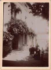 Small group gathered around a curate, Chasselay by Ph. Damour (c.1900) (pellethepoet) Tags: photograph groupportrait chasselay rhne france europe damour phdamour philippedamour house maison architecture curate children boys enfants garons redborder