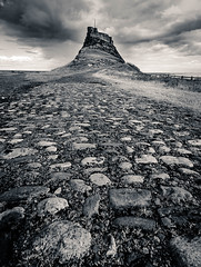 Path to the castle (catkin314) Tags: lindisfarne holyisland bw blackandwhite cobbles contrast wideangle castle clouds northumberland northumbria