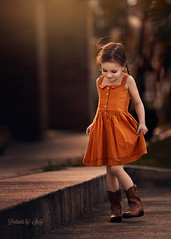 These Boots (Portraits by Suzy) Tags: cute children pretty smile hair summer female young beauty model fashion girl beautiful light nature childhood warm autumn fall portraits by suzy mead color natural candid moment