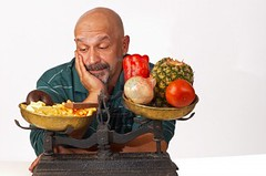 7749525-dieting-man-anxiously-looking-at-what-he-should-not-eat (burnetbuddy) Tags: weightloss healthydiet rawfooddiet mediterraneandiet safeweightloss rapidweightloss