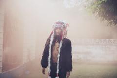 fever dreams. (levi walton) Tags: original sun beach colors girl leather haze native indian smoke hipster feathers makeup jacket american panama headdress gorgona