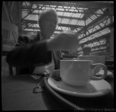 6-23-11.  Tea at Bonaparte's Cafe, Waterloo Station, London.  2 second pinhole exposure. (squaremeals) Tags: london station cafe tea waterloo teacup pinholephotography bonapartes squaremeals 237pinhole petercaws