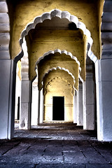 Dark arches, Jodhpur Fort, Rajasthan (MJ Reilly) Tags: shadow india black classic yellow dark nikon arch sinister traditional arches ombre doorway hdr rajasthan jodhpur d90 kathputhlismehrangarhfort