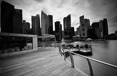 Marina Bay, Singapore in B&W (Muhammad Faisal Othman) Tags: street city travel sky panorama building tower tourism monument beautiful skyline architecture modern night skyscraper outdoors corporate lights office high construction cityscape technology tour view place famous landmark scene icon images tourist structure professional business national commercial workplace getty tall concept success development metropolitan attraction gettyimages