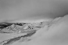 A Cold Place (Jesse Childers) Tags: winter snow clouds blackwhite nevada aerialview aerial wintersnow graysky cloudysky mountainrange snowcoveredmountains shotfromaplane jessechilders nikond7000