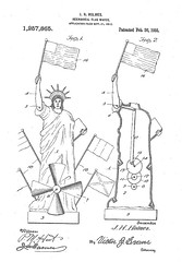 Liberty Wigwagging the World (LisaGenius) Tags: mechanical flag statuette