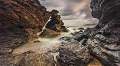 The Gate Of Ostolia (Ahmad Fahmi (markthedg)) Tags: sunset bw orange seascape water rock stone long exposure slow smooth filter 09 lee shutter scapes landsacpe gnd nd110