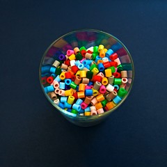 A Glass of Different Coloured Plastic Beads (slightly everything) Tags: uk england black glass square creativity one beads rainbow europe different little plastic 365 coloured lightbright katehiscock getty365 aglassofdifferentcolouredbeads