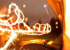 Happy New Year (2013-01-01) (baumbaTz) Tags: lightpainting canon eos rebel kiss fireworks january sparklers fisheye sparkler 8mm manualfocus walimex wunderkerze januar feuerwerk lichtmalerei x3 500d samyang wunderkerzen 2013 rebelt1i kissx3 t1i 20130101