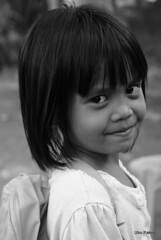 bw portrait of a young girl (ubo_pakes) Tags: street city portrait bw girl smile face up closeup pose hair happy photo blackwhite big eyes nikon asia pretty close philippines young photograph backpack cebu pinay filipina lovely visayas d60 ubo beeautiful pakes inayawan mygearandme inayawanriversidedistribution