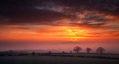 Wrekin Red Delight (Natasha Bridges) Tags: morning winter red sky mist clouds sunrise countryside shropshire fields wrekin