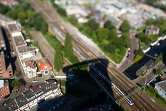 Den Haag, Netherlands (Tobias Mnch) Tags: city railroad shadow urban building netherlands architecture skyscraper train europe tracks nederland railway denhaag highrise thehague tiltshift minuature haagsetoren hetstrijkijzer