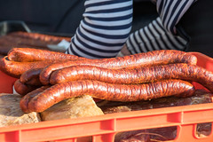sausage at the  Prague farmers' market (Paul and Jill) Tags: prague praha newtown novmsto farmersmarket sausage stripes