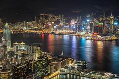 Ship To Ship (Tim van Zundert) Tags: hong kong island tsim sha tsui china city cityscape landscape night evening long exposure sky100 international commerce centre icc buildings architecture water reflection river bay light trails towers sony a7r sel55f18z zeiss 55mm