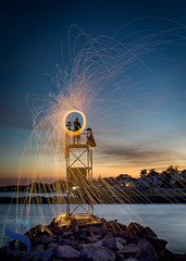 Steel Wool Spinning from Tower (Singing With Light) Tags: 2016 4th alpha6000 augustmirrorless gulfbeach singingwithlight sonya6000 surf06 firewall lightspinning photography pixelstick singingwithlightphotography sony spinning sunset umbrella