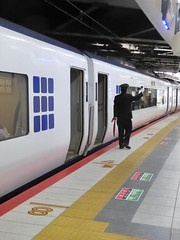 Lingering on the platform (seikinsou) Tags: japan spring osaka kix kansai airport haruka jr train shinosaka kyoto platform crew guard uniform