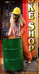 Joke shop in Regent Road, Great Yarmouth (lizzieisdizzy) Tags: man mannekin shop outside street water running overalls orange mouth sick tatty hair yellowhelmet longhair joke jokes tricks magic shirt checked publicwalkway