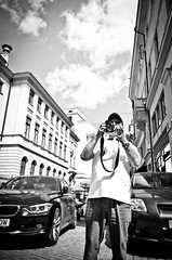 Tourist with a Camera (stimpsonjake) Tags: nikoncoolpixa 185mm streetphotography bucharest romania city candid blackandwhite bw monochrome tourist camera man centrulvechi