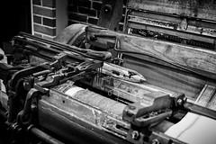 Loom and shuttle (trochford) Tags: loom shuttle bobbin bobbinspool bobbinspoolshuttle automaticloom lowellnationalhistoricalpark nationalpark lowell lowellma lowellmassachusetts ma massachusetts newengland usa bw blackandwhite blackwhite mono monochrome indoor interior canon