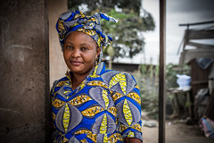 Woman with Blue Dress (02Marzo2010) Tags: pointenoire republicofthecongo cg woman portrait blue dress hat bkack ebony africa stare eyes face sunday visiting