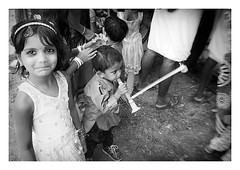 the party-blower trumpet player (handheld-films) Tags: india rural portrait portraiture candid group people children brother sister boy girl family families outdoor fun festivities celebrations mono blackandwhite indian kerala subcontinent