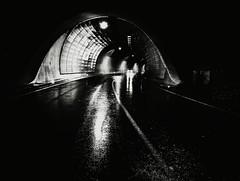 He Is On His Way (Yves Roy) Tags: street city shadow urban blackandwhite bw black contrast dark austria blackwhite raw moody darkness noiretblanc 28mm snap fav20 gloom fav30 yr enigmatic fav10 ricohgrd grdiii bureboke yvesroy yrphotography