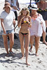 Candice Swanepoel poses at a photo shoot for Victoria's Secret Swimwear Collection on the beach in St. Barts