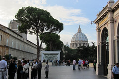 St. Peter's Basilica (Jocey K) Tags: trees sky people italy rome art architecture clouds buildings gates details arches courtyard stpetersbasilica vaticancity wondows cosmostour6330