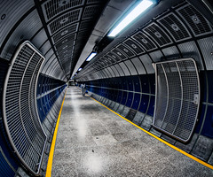 Mission Accomplished - Explored (Sean Batten) Tags: city uk blue light england urban london yellow londonbridge underground subway person nikon cityscape tube tunnel fisheye commuter hdr d90
